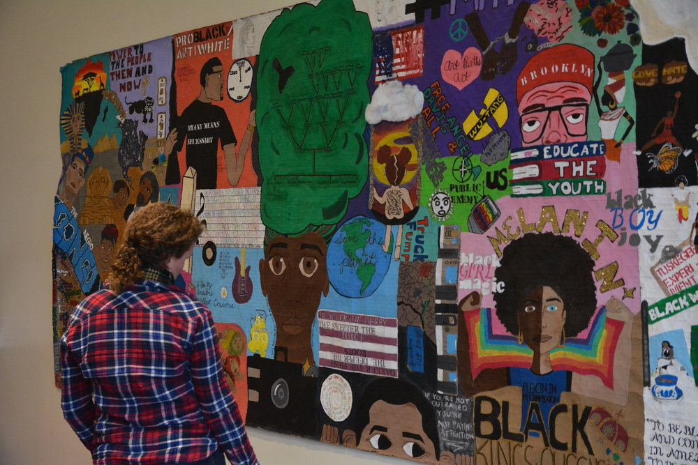 The Creative Intersectionality: Culture and the Environment Exhibit is displayed in the Student Union and features artwork by representatives of each of the six UConn cultural centers. The exhibition includes photographs, quilts, and murals to offer perspectives on the environment from different cultures. (Olivia Stenger/The Daily Campus)