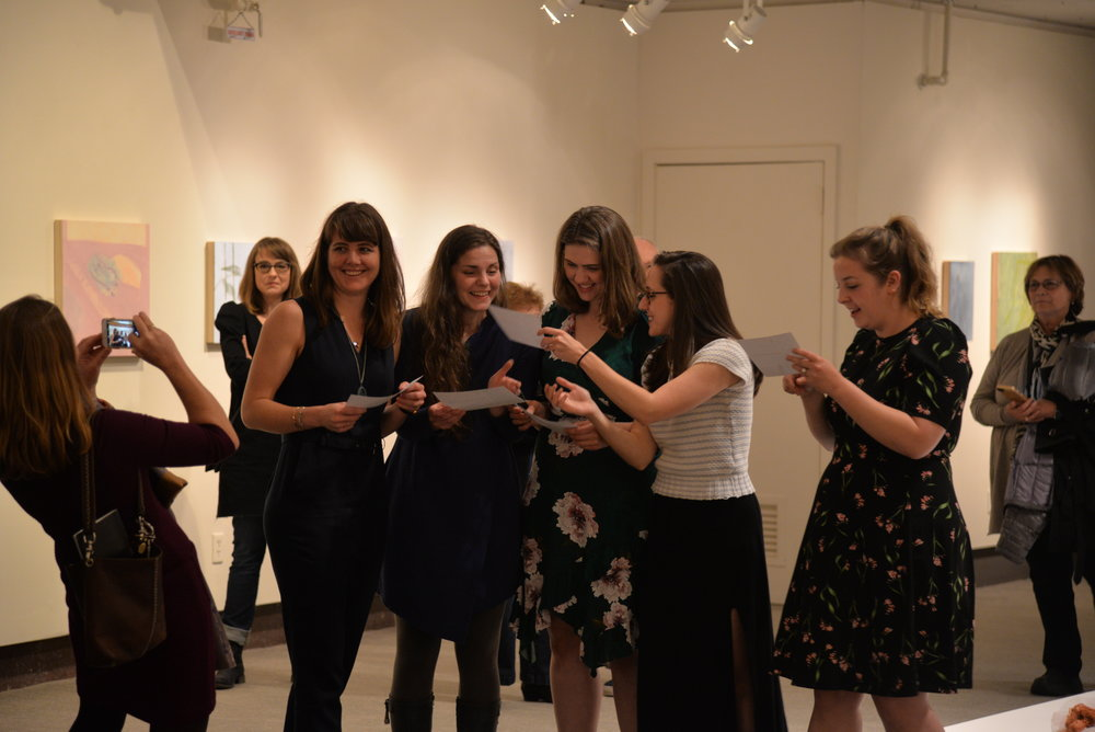 The 2018 Master of Fine Arts class presents their thesis work in the Benton Museum on Thursday night. (Amar Batra/The Daily Campus)