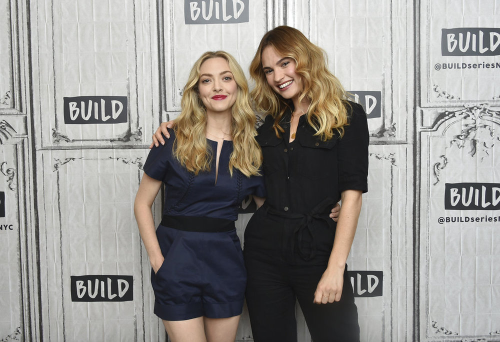 "Actors Amanda Seyfried, left, and Lily James attend a BUILD Speaker Series to promote their film ""Mamma Mia! Here We Go Again"" at AOL Studios on Thursday, July 19, 2018, in New York. (Photo by Evan Agostini/Invision/AP)"