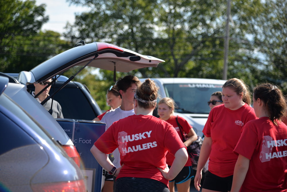"""Volunteers called """"Husky Haulers"""" help move in UConn students during the move-in period. (File photo/The Daily Campus)"""
