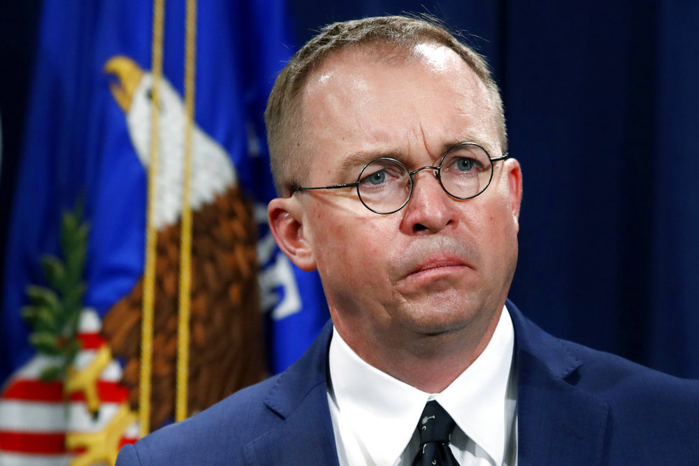 FILE- In this July 11, 2018, file photo Mick Mulvaney, acting director of the Consumer Financial Protection Bureau (CFPB), and Director of the Office of Management, listens during a news conference at the Department of Justice in Washington. (AP Photo/Jacquelyn Martin, File)