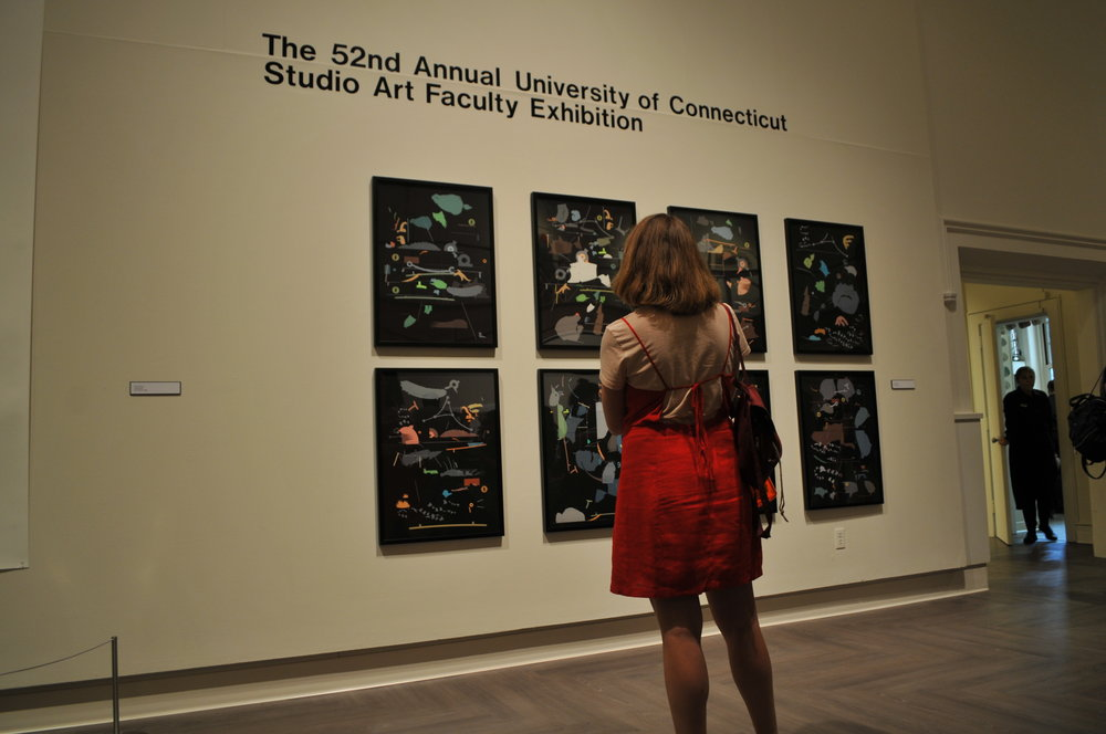 Art-lovers explore the opening of the 52nd Annual Studio Art Faculty Exhibition on display at the William Benton Museum of Art on September 6, 2018. The exhibition will be at the Benton until October 14, 2018. (Judah Shingleton/The Daily Campus)
