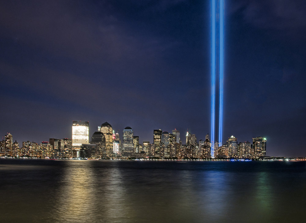 In remembrance of the September 11, 2001 attacks shines the Tribute in Light art installation of 88 six blocks south of the World Trade Center on top of the Battery Parking Garage in New York City.(Ben Jagendorf/Flickr Creative Commons)