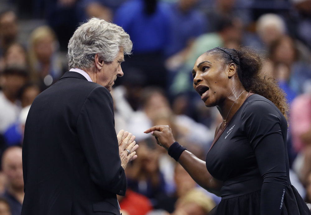 In this Saturday, Sept. 8 file photo, Serena Williams, right, talks with referee Brian Earley during the women's final of the U.S. Open tennis tournament against Naomi Osaka, of Japan, in New York. (Adam Hunger, File/AP)