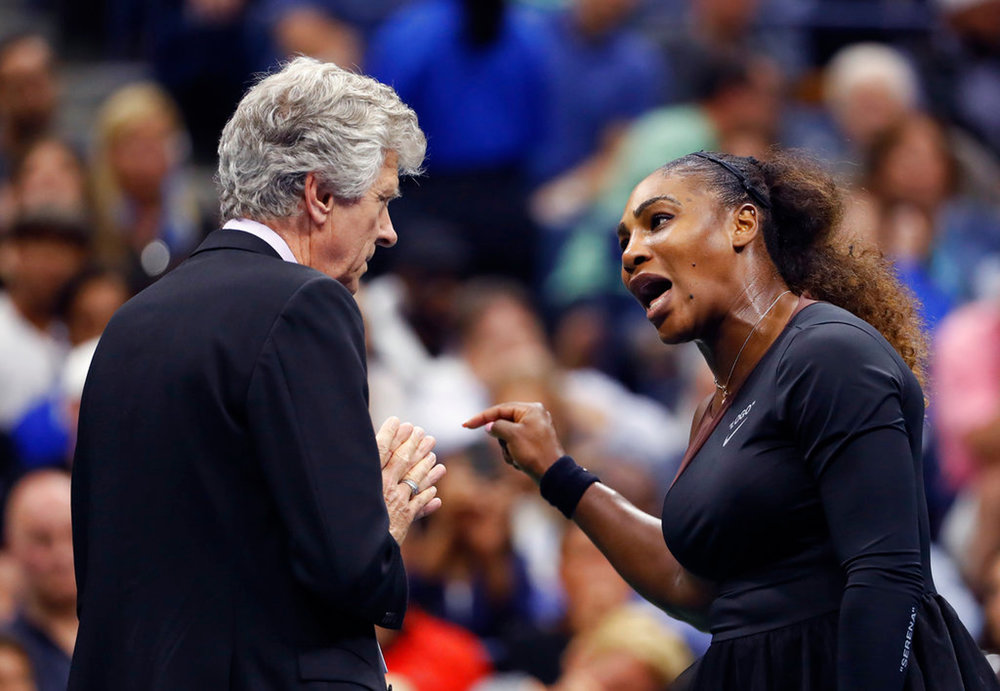 "In this Saturday, Sept. 8, 2018, file photo, Serena Williams, right, talks with referee Brian Earley during the women's final of the U.S. Open tennis tournament against Naomi Osaka, of Japan, in New York. Some black women say Serena Williams' experience at the U.S. Open final resonates with them. They say they are often forced to watch their tone and words in the workplace in ways that men and other women are not. Otherwise, they say, they risk being branded an ""Angry Black Woman."" (AP Photo/Adam Hunger, File)"