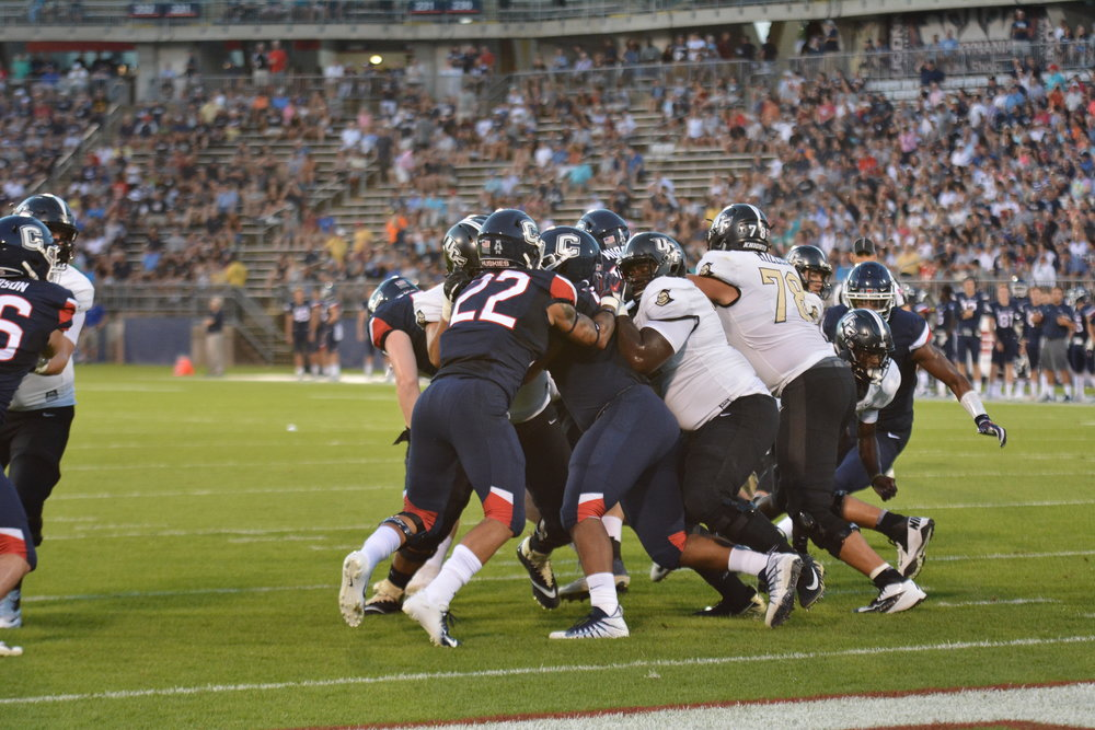 The UConn Huskies took a hard opening loss this fall season to University of Central Florida 56-17. They look to learn from this Top 20 team and bounce back on their next home game on 9/15 against University of Rhode Island. (Photo by Eric Wang)