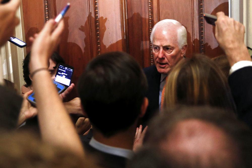 Senate Majority Whip Sen. John Cornyn, R-Texas, responds to reporters' questions on Supreme Court nominee Brett Kavanaugh Tuesday, Sept. 18, 2018, on Capitol Hill in Washington. (AP Photo/Jacquelyn Martin)