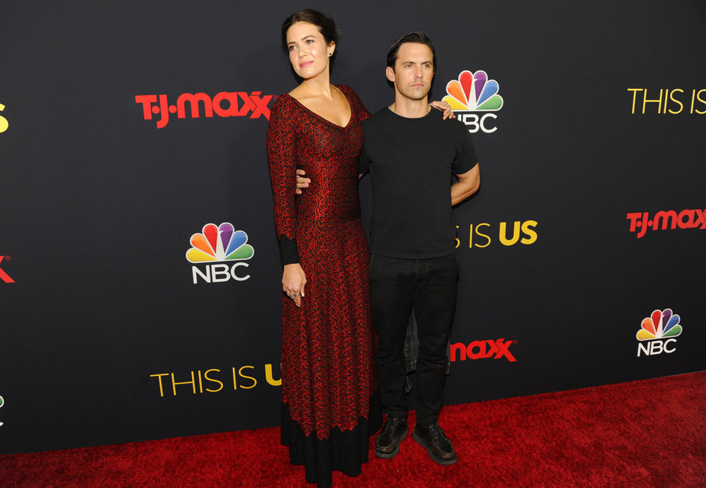 "Mandy Moore, left, and Milo Ventimiglia arrive at a season three premiere screening of ""This Is Us"" on Tuesday, Sept. 25, 2018, at Paramount Studios in Los Angeles. (Photo by Chris Pizzello/Invision/AP)"