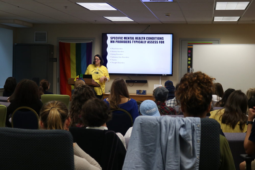 Clinical psychologist Jennifer Petro presents about issues surrounding mental health and societal acceptance of transgender individuals in the Rainbow Center (Maggie Chafouleas/The Daily Campus