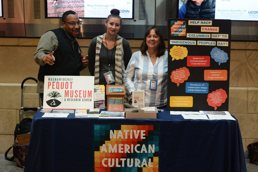 UConn Native American Cultural Programs holds a table in the Student Union first floor to petition for Columbus Day to be changed to Indigenous People's Day. Representatives of the Mashantucket Pequot Museum also helped to run the table and give out information on Native American educational resources. The table is part of this week's Indigenous People's Week activities and will be active each day this week from 9:00am to 5:00pm. (Judah Shingleton/The Daily Campus)