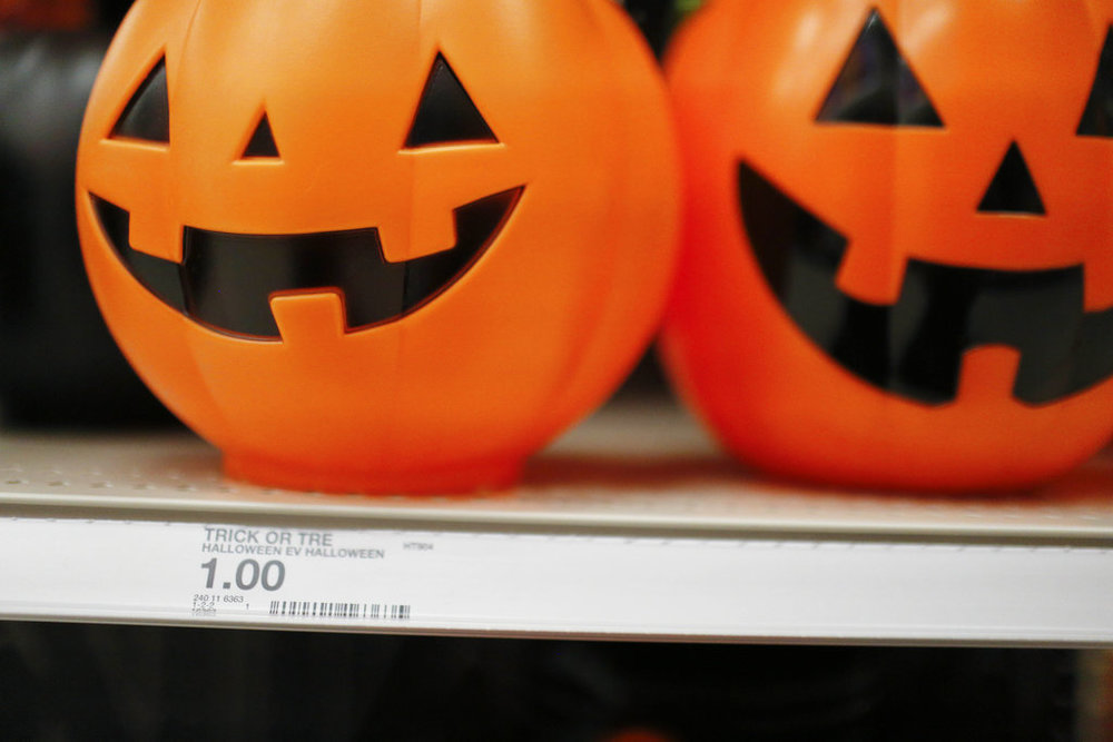 """A pumpkin bucket is displayed in the Halloween section called """"Hyde and Eek"""" at a Target department store on Wednesday, Oct. 3, 2018, in Pembroke Pines, Fla. Discounters like Walmart and Target are expanding their costume offerings and creating designated sections where customers can find more of their Halloween needs in one place. (AP Photo/Brynn Anderson)"""