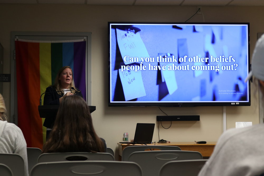 "Julia Anderson presents on misconceptions and issues surrounding the process of ""coming out"" in the LGBTQI community in the Rainbow Center. The Out to Lunch lecture fell on National Coming Out day, October 11th. (Photo by Maggie Chafouleas/The Daily Campus)"