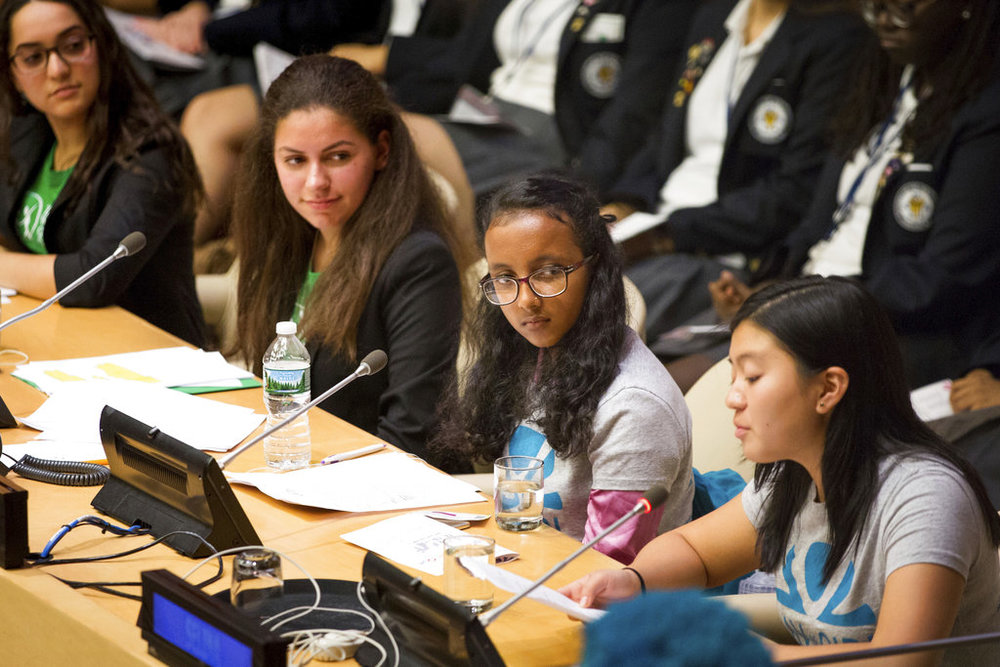 IMAGE DISTRIBUTED FOR GLOBAL G.L.O.W. - Global G.L.O.W. representative Shreeya, 14, center, of Nepal, looks on during the Global G.L.O.W. (Girls Leading Our World)'s presentation, part of the UN's Working Group on Girls 'Speak Out' event at the United Nations headquarters on Thursday, October 11, 2018, in New York. The event coincides with the U.N.-recognized International Day of the Girl. (Kevin Hagen/AP Images for Global G.L.O.W.)