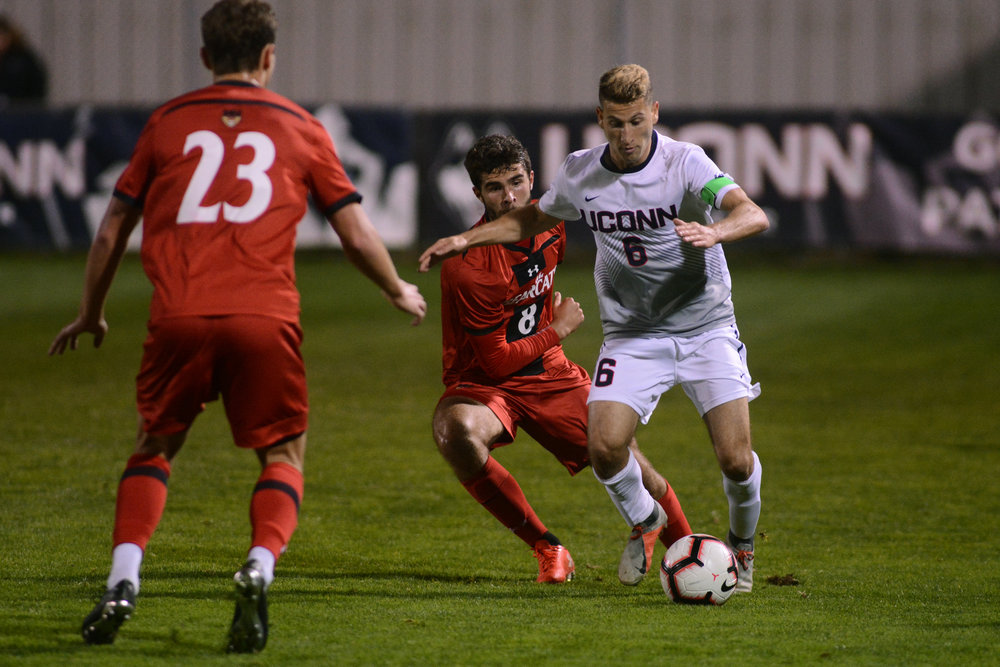 Dylan Greenberg fights off Cincinnati defenders during a game on Saturday, Oct. 6 at Morrone Stadium. The Huskies take on Boston College Tuesday night at home. (Nicholas Hampton, Associate Photo Editor/The Daily Campus)