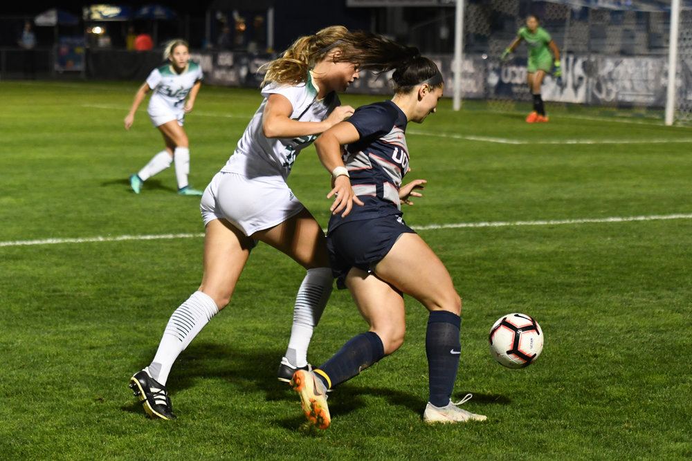 Sophia Danyko-Kulchycky fights off a South Florida defender during a game on Thursday, Sept. 27 at Morrone Stadium. (Nicholas Hampton, Associate Photo Editor/The Daily Campus)