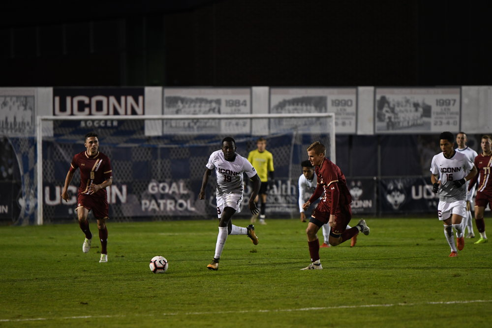 UConn Sophomore midfielder Blaise N'Gague navigates the Boston College defense during the Huskies' 3-2 victory on Oct. 16, 2018.