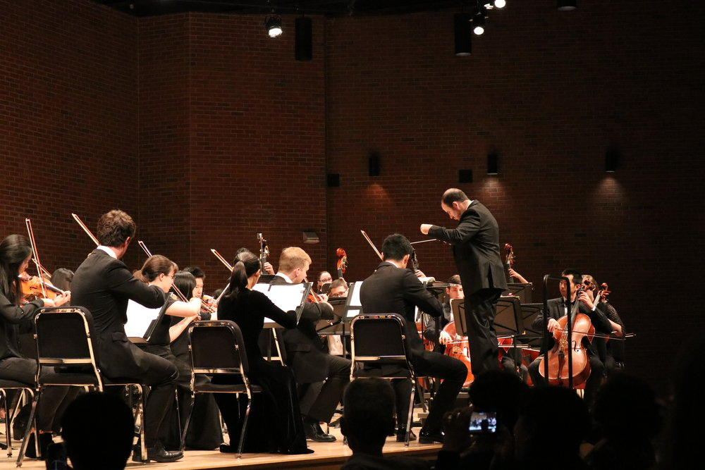 "The UConn Symphony Orchestra performs a show titled ""Dances in Masks"" in von der Mehden Recital Hall on Thursday night. The show featured works by Bernstein, Fuchs, Saint-Seans, and Tchaikovsky. (Photo by Maggie Chafouleas/The Daily Campus)"