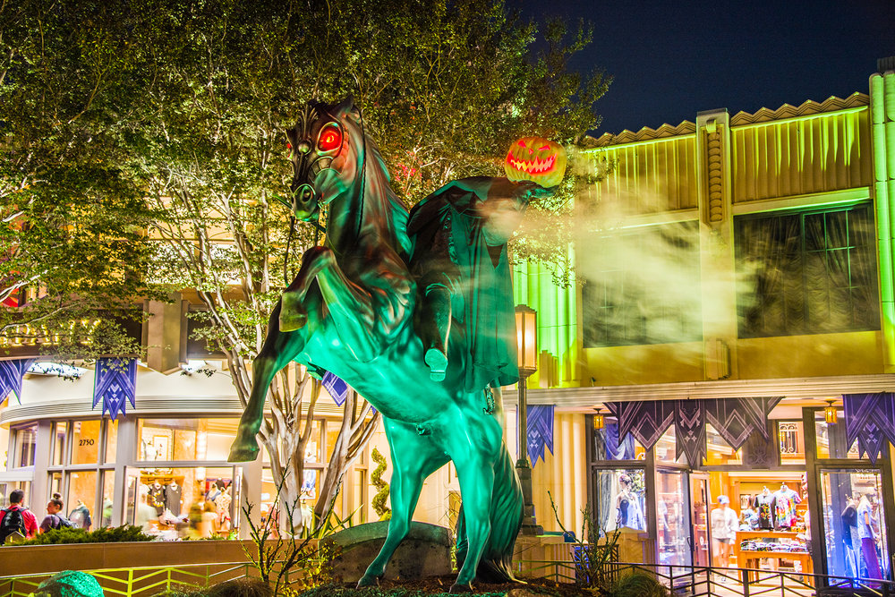 A statue of a headless horseman lights up at night. (Photo courtesy of Flickr Creative Commons)