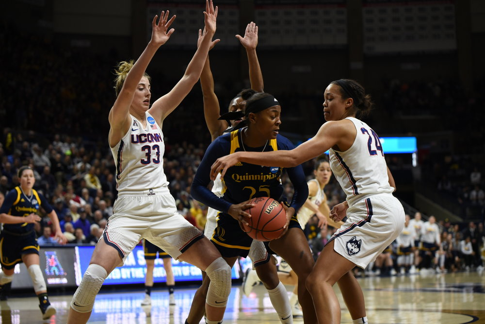 In an in-state battle against Quinnipiac for the second round of the NCAA Tournament, then juniors Napheesa Collier and Katie Lou Samuelson lock up on defense (Charlotte Lao/The Daily Campus)