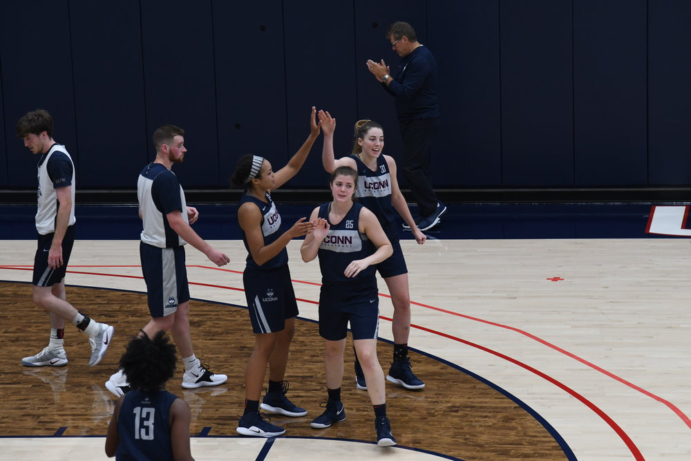 Coach Geno Auriemma approves of a stellar play during UConn women's basketball practice Friday. Photo by Charlotte Lao, Photo Editor/The Daily Campus