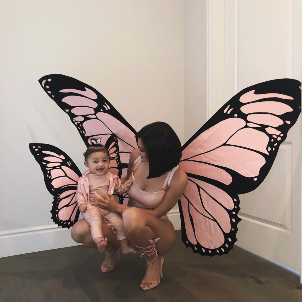 "For Stormi's first Halloween, the mother-daughter duo dressed up as butterflies, inspired by Travis Scott's album ""The Butterfly Effect."" (@kyliejenner/Instagram)"