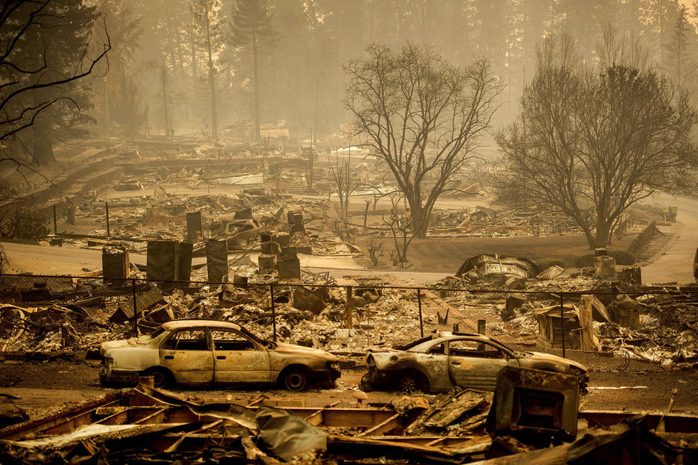 Homes leveled by the Camp Fire line a development on Edgewood Lane in Paradise, Calif., Monday, Nov. 12, 2018. (AP Photo/Noah Berger)