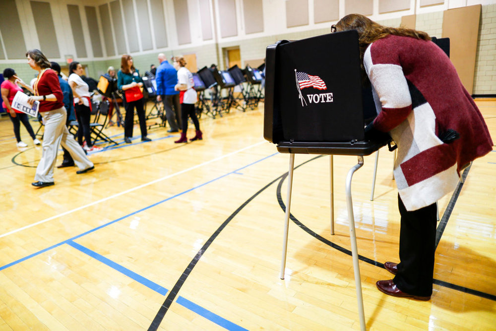 Voters cast their ballots at the Whetstone Community Center polling location, Tuesday, Nov. 6, 2018, in Columbus, Ohio. Across the country, voters headed to the polls Tuesday in one of the most high-profile midterm elections in years. (AP Photo/John Minchillo)