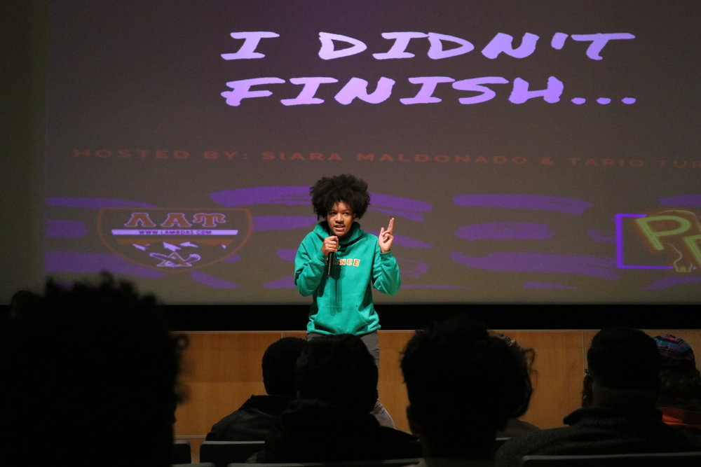 "Participants of an event named ""I Didn't Finish..."" sing, dance, and compete in a poetry slam in the Student Union Theater on Tuesday night. The event was sponsored by Poetic Release and Lambda Alpha Upsilon fraternity. (Photo by Maggie Chafouleas/The Daily Campus)"