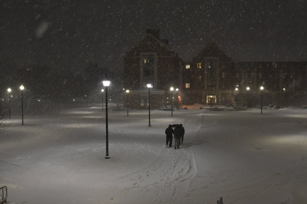 UConn students explore campus after a fall snow. (Brandon Barzola/ The Daily Campus)