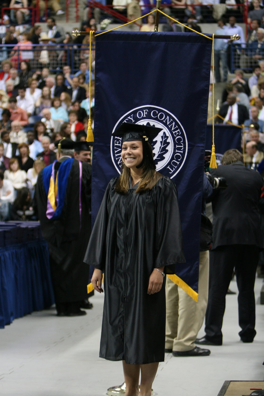 A University of Connecticut graduate walks at a 2007 graduation ceremony in Gampel Pavilion (File Photo/The Daily Campus)