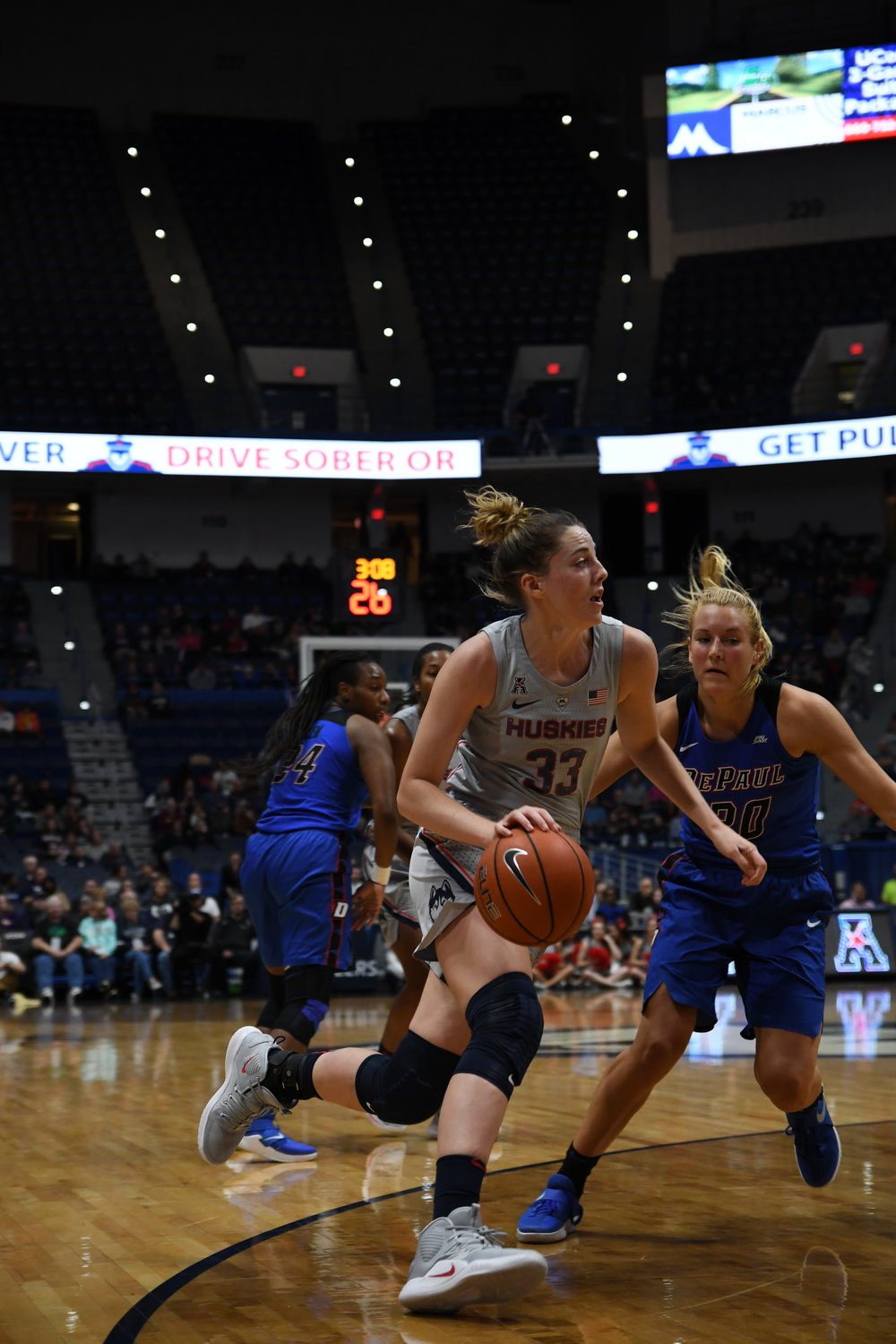 Katie-Lou Samuelson drives on DePaul during the Huskies' 99-63 win. (Judah Shingleton/ The Daily Campus)