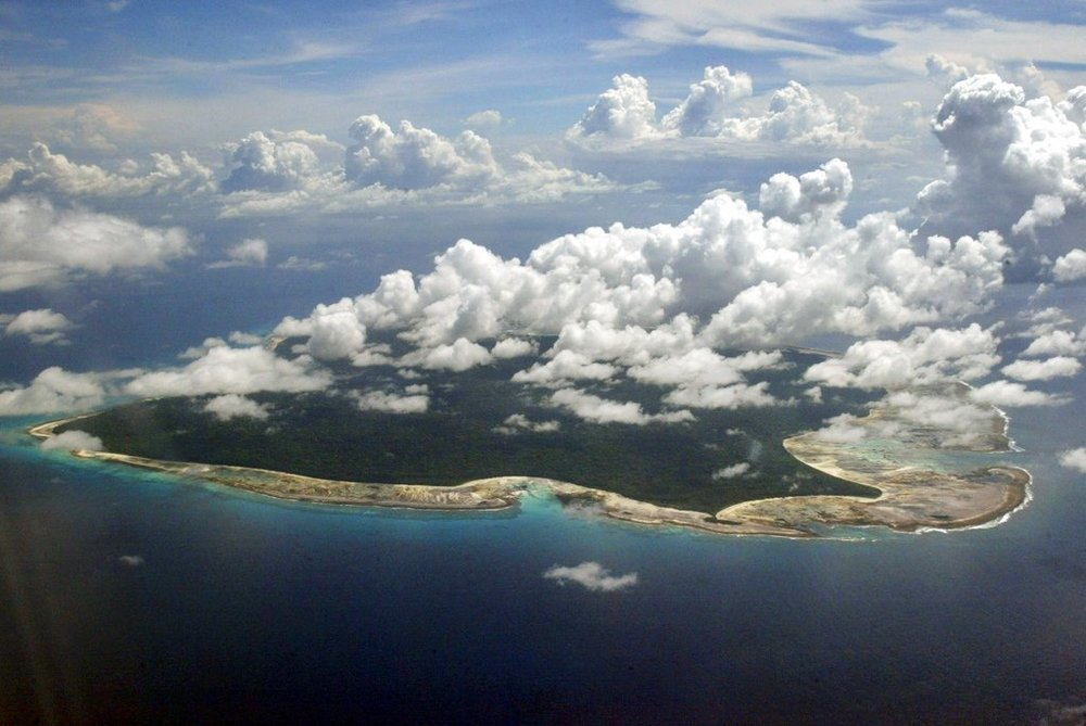 FILE – In this Nov. 14, 2005 file photo, clouds hang over the North Sentinel Island, in India's southeastern Andaman and Nicobar Islands. An American is believed to have been killed by an isolated Indian island tribe known to fire at outsiders with bows and arrows, Indian police said Wednesday, Nov. 21, 2018. Police officer Vijay Singh said seven fishermen have been arrested for facilitating the American's visit to North Sentinel Island, where the killing apparently occurred. Visits to the island are heavily restricted by the government. (AP Photo/Gautam Singh, File)
