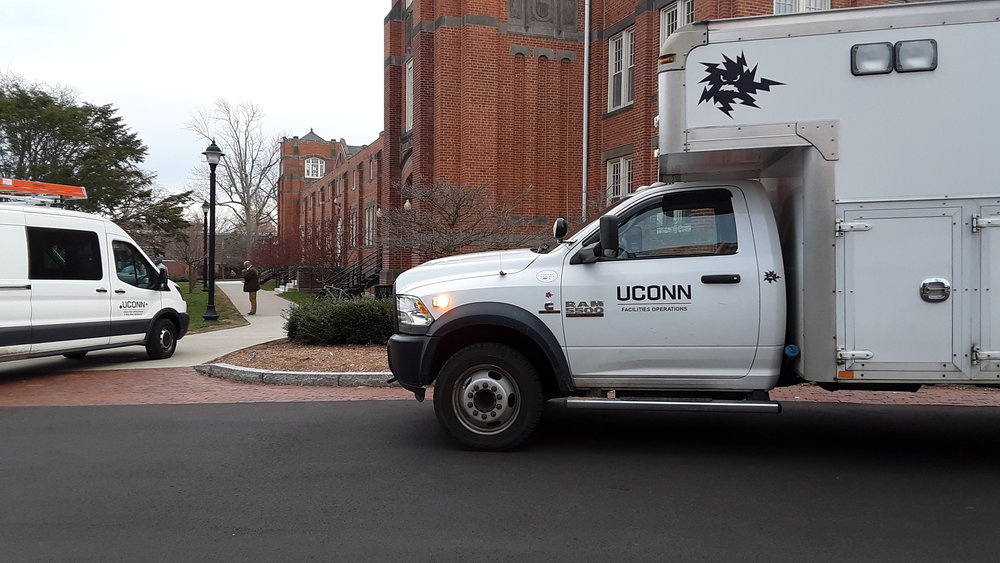 UConn facilities operations vehicles park outside Hawley Armory to resolve a power outage. The University of Connecticut experienced a large-scale power outage early Wednesday afternoon on the east side of campus. (Photo by Marlese Lessing/News Editor, The Daily Campus)