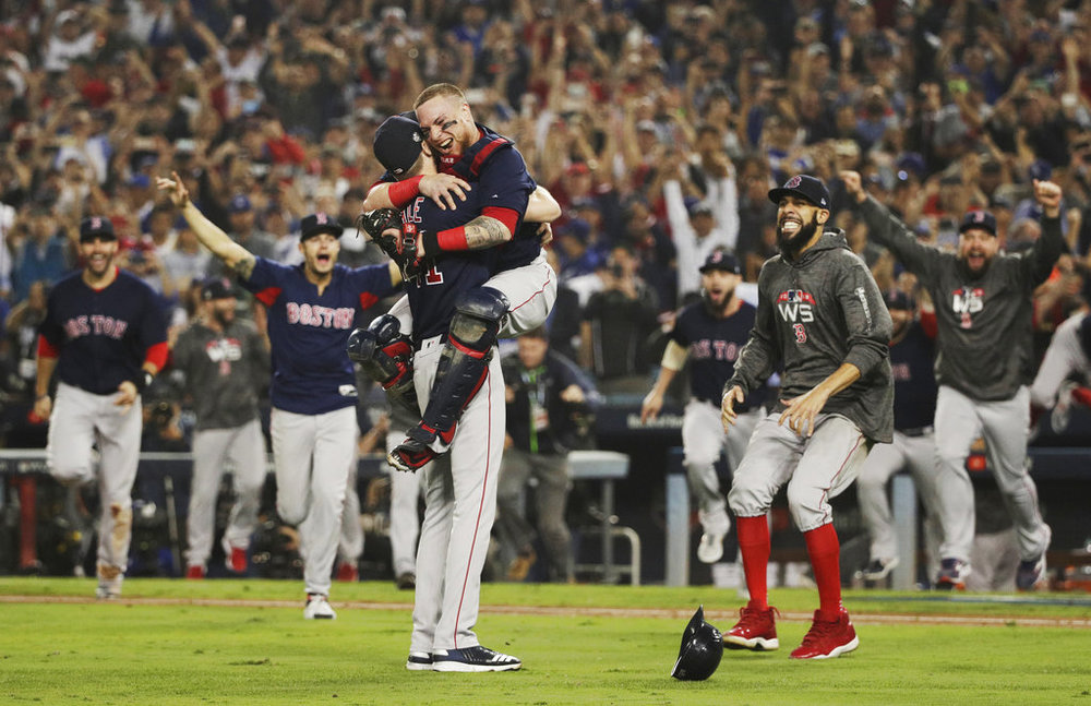 For most of the people on the staff, the Boston Red Sox winning the World Series was their favorite sports memory of 2018. (AP Photo/Jae C. Hong)