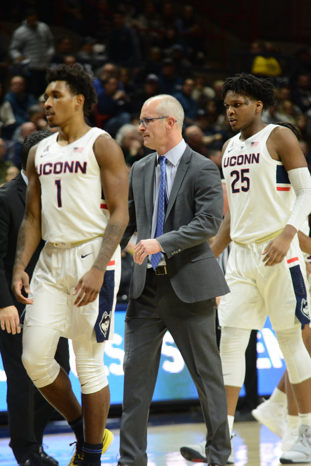 Christian VItal (left) walks with UConn head coach Dan Hurley (center) and Josh Carlton (right). Vital scored 18 points and joined the 1,000 point club, and Carlton scored a career-high 18 points in UConn's win on Saturday at Gampel. (Eric Wang/The Daily Campus)