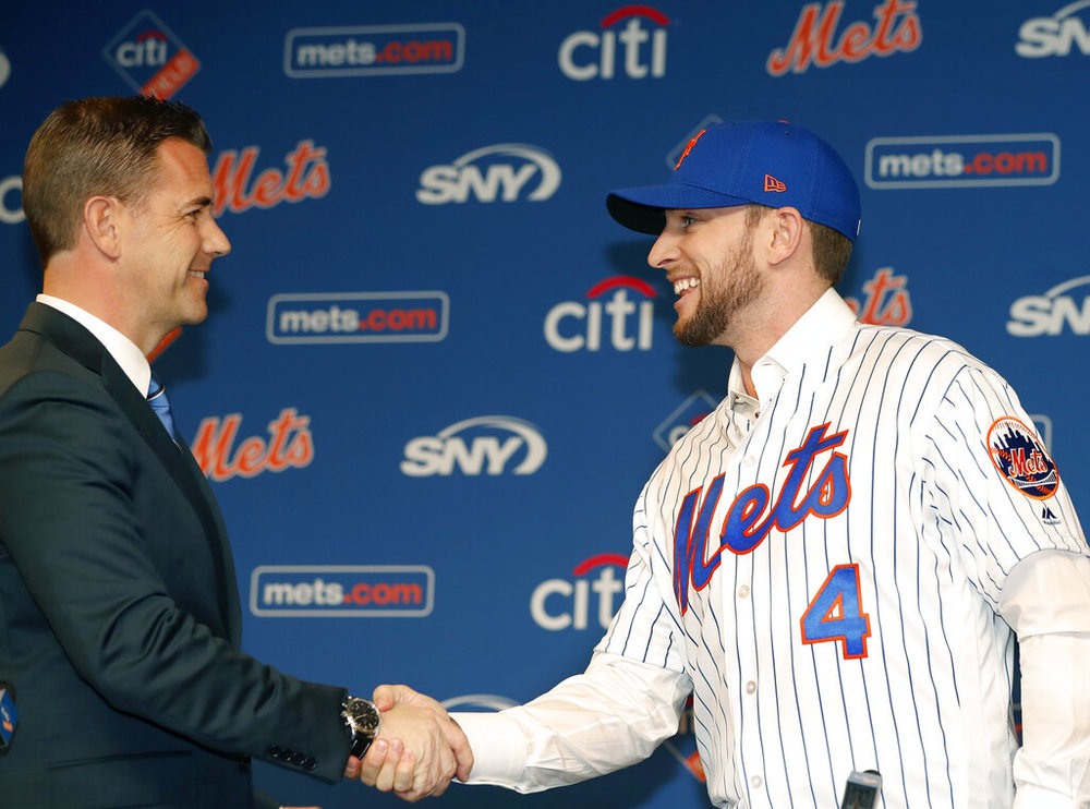 New York Mets General Manager Brodie Van Wagenen, left, welcomes All-Star infielder Jed Lowrie to the team after Lowrie signed with the Mets, Wednesday, Jan. 16, 2019, in New York. (AP Photo/Kathy Willens)