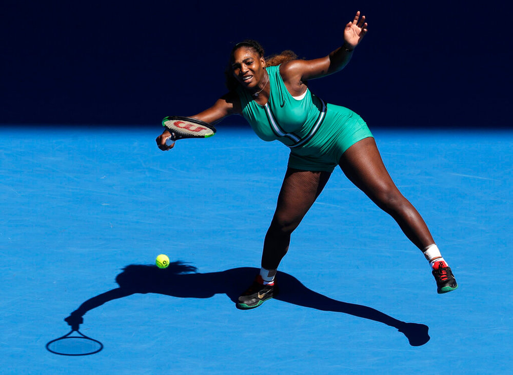 United States' Serena Williams makes a forehand return to Karolina Pliskova of the Czech Republic during their quarterfinal match at the Australian Open tennis championships in Melbourne, Australia, Wednesday, Jan. 23, 2019. (AP Photo/Mark Schiefelbein)