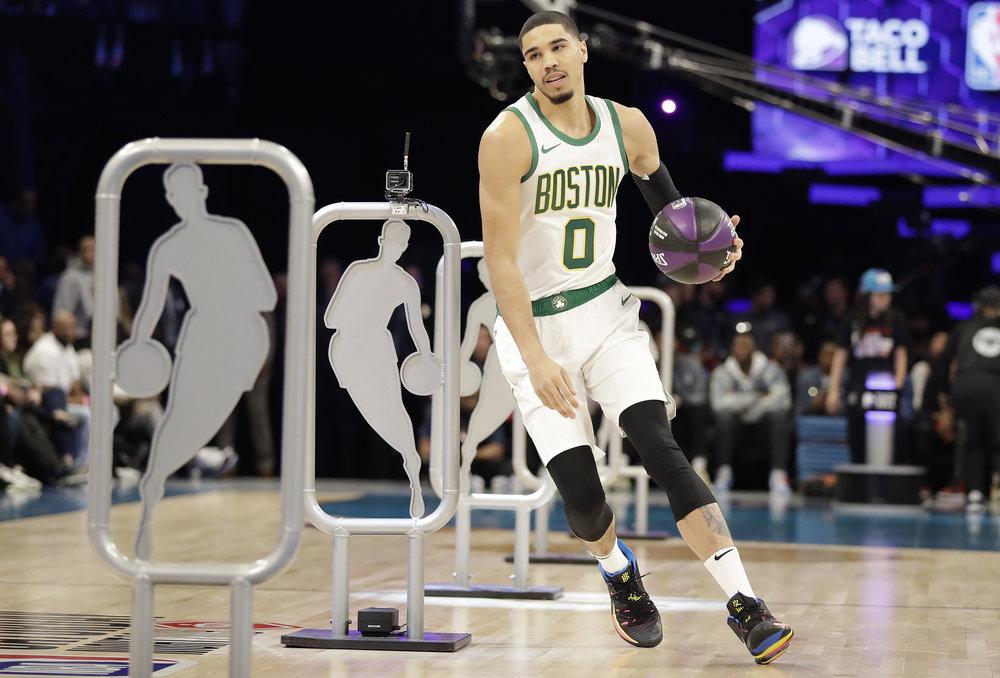 Boston Celtics Jayson Tatum participates during the NBA All-Star skills session basketball contest, Saturday, Feb. 16, 2019, in Charlotte, N.C. (AP Photo/Chuck Burton)