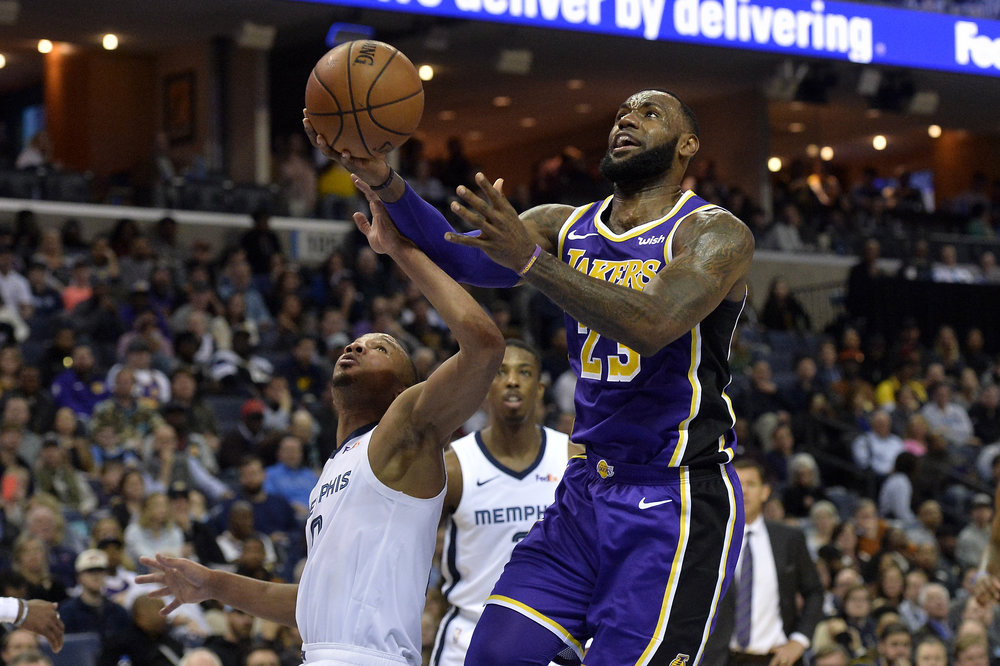 Los Angeles Lakers forward LeBron James (23) drives to the basket against Memphis Grizzlies guard Avery Bradley (0)in the first half of an NBA basketball game Monday, Feb. 25, 2019, in Memphis, Tenn. (AP Photo/Brandon Dill)