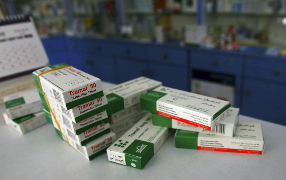 In this Friday, Feb. 15, 2019 photo, boxes of Tramal, an addictive pain killer, are stacked on the table of a pharmacy in Gaza City. (AP Photo/Adel Hana)