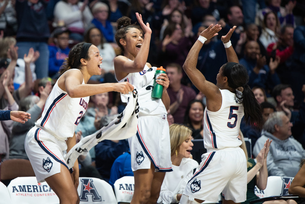The Huskies celebrate after yet another American Conference win. (Charlotte Lao/The Daily Campus)