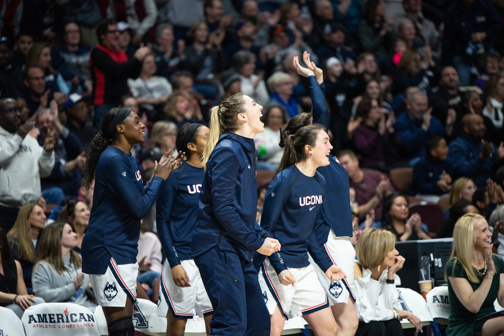 The Huskies' bench celebrates as the team moves on to yet another American Conference Championship. (Charlotte Lao/The Daily Campus)