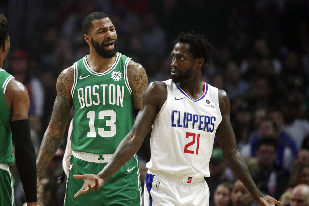 Los Angeles Clippers' Patrick Beverley, right, argues with Boston Celtics' Marcus Morris during the first half of an NBA basketball game, Monday, March 11, 2019, in Los Angeles. (AP Photo/Jae C. Hong)