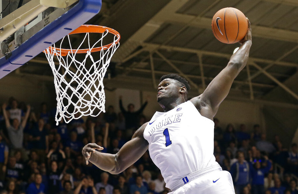 FILE - In this Jan. 5, 2019, file photo, Duke's Zion Williamson (1) dunks during the second half of an NCAA college basketball game against Clemson, in Durham, N.C. Williamson was named both The Associated Press ACC player and newcomer of the year, Tuesday, March 12, 2019. (AP Photo/Gerry Broome, File)