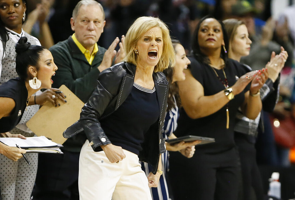 Baylor head coach Kim Mulkey instructs her team against Iowa State during the first half of an NCAA college basketball game in the Big 12 women's conference tournament championship in Oklahoma City, Monday, March 11, 2019. (AP Photo/Alonzo Adams)