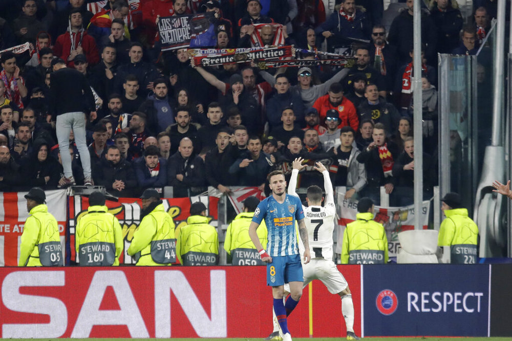 Juventus' Cristiano Ronaldo reacts in front of Atletico fans at the end of the Champions League round of 16, 2nd leg, soccer match between Juventus and Atletico Madrid at the Allianz stadium in Turin, Italy, Tuesday, March 12, 2019. (AP Photo/Luca Bruno)