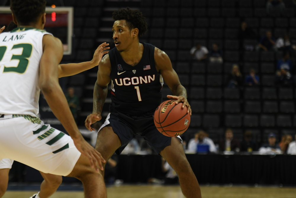 Christian Vital handles the ball in UConn's 80-73 win over USF in the first round of the American Athletic Conference Tournament on Thursday, March 14 at the FedExForum in Memphis, Tenn. (Photo by Judah Shingleton/The Daily Campus)