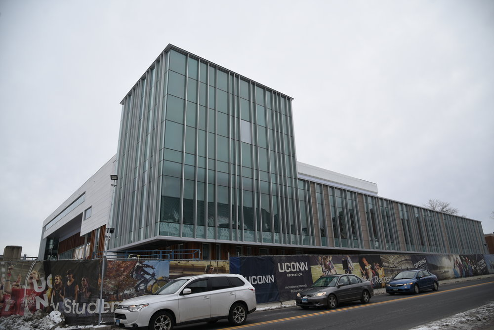 The new recreational center is under construction and is said to finish for the Fall semester across the UConn Bookstore. It is said that there will be an additional fee for the new gym. (Photo by Charlotte Lao/The Daily Campus)