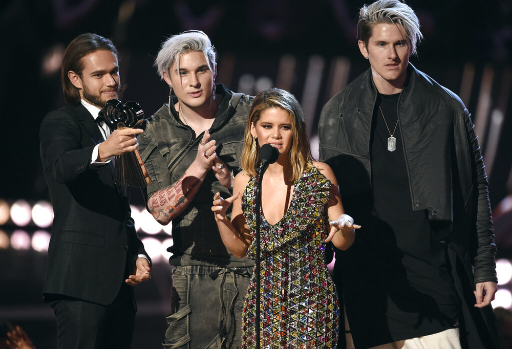 "Michael Trewartha, second left, and Kyle Tree, right, of Grey, Zedd, left, and Maren Morris accept the award for song of the year for ""The Middle"" at the iHeartRadio Music Awards on Thursday, March 14, 2019, at the Microsoft Theater in Los Angeles. (Photo by Chris Pizzello/Invision/AP)"