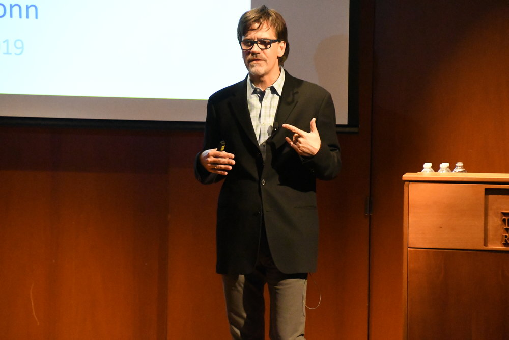 """Stephen Russell speaks to a group of students in the Konover auditorium about issues surrounding the LGBTQ community. Russell focused on issues regarding harassment in youth and why these issues are not """"getting better"""" as many people believe. (Julie Spillane/The Daily Campus)"""